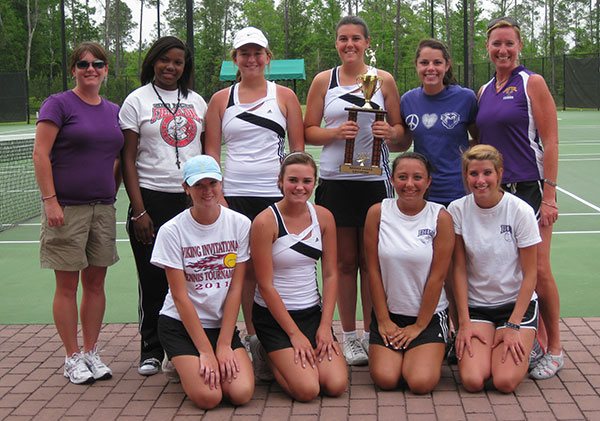 GIRLS TENNIS REGION CHAMPIONS from Bainbridge High School, with the trophy they won Thursday, are front row, left to right, Lynsey Waddell, Emma Kate Smith, Kelly Brooks, Meredith Conder; back row, Coach Amy Thomas, Destiny Salter, Anne Reynolds, Malori Maxwell, Kristen Monson and Tournament Director Tabitha Spooner.