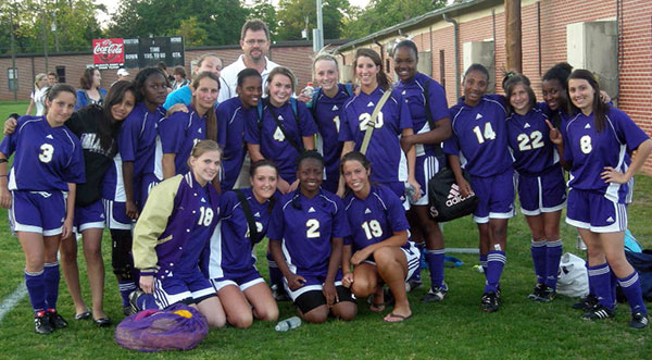 COACH CHIP ARIAIL gets together with his 2011 Bainbridge High School Lady Cats soccer team following their successful 2011 season. From left to right are, front row, seniors Jessica Dunlap, Robbi Howard, Candace Perkins and Bailey Wells; back row, Amber Braswell, Amadelia Barrious, Tiffany Pearson, Tiffany Hand, Isis Crawford, Caitlyn Cato, Coach Ariail,  Savannah Cook, Charlton Reynolds, McKenzie Conder, Brianna Williams, Katriva Thomas, Paige Braswell, Anye Miller and Lyndi Denham. Not pictured are April Thomas, Lindsay Unfricht, Anissa Jackson, Ashten Oldaker and Shemelia Bush.