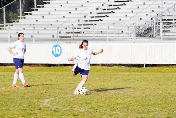 Caitlin Cato kicks