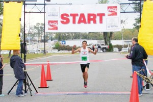 Nineteen-year-old Stanley Linton, of Crawfordville, Fla., crosses the finish line with the first overall time of 1 hour, 17 minutes, 27 seconds, in the second annual Bainbridge Half Marathon on Saturday.