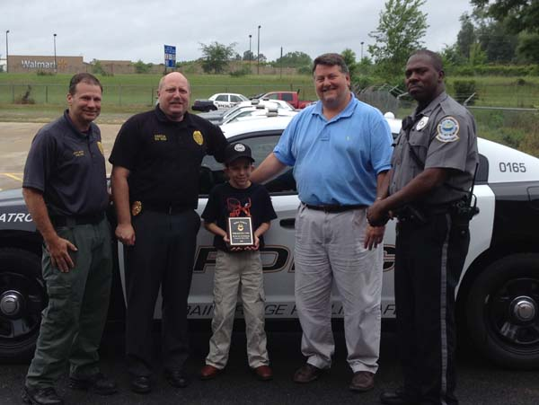 """A DAY TO REMEMBER: Dallas Thigpen, a student at Bainbridge Middle School, recently took part in Bainbridge Public Safety's """"Officer for a Day"""" program. Recognizing Thigpen for his participation in the program are, from left to right, Deputy Public Safety Director Frank Green, Public Safety Director Eric Miller, Thigpen, Bainbridge City Manager Chris Hobby and BPS Sgt. Marvin Knight."""