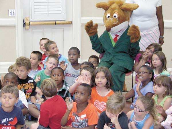 GERONIMO STILTON is surrounded by children from the YMCA summer camp.