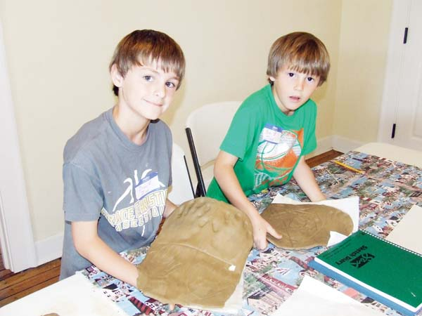 Drew Ryan and Pate Beckham show off their clay tablets.