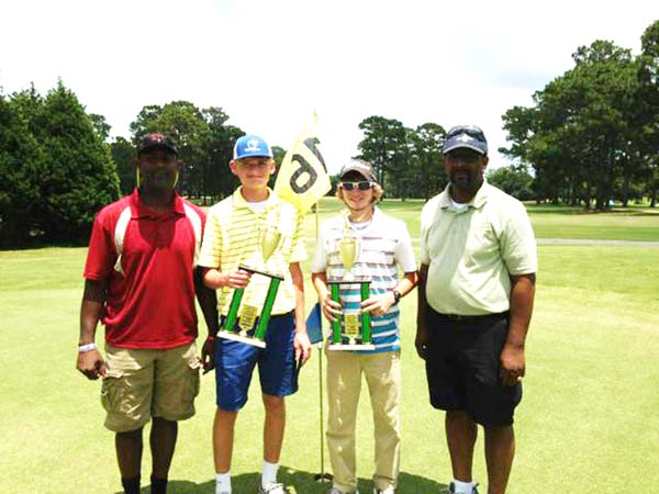 TOURNAMENT WINNERS: The Bainbridge team of Matthew Green and Kyle Horne shot a 67 to win the 2013 Deltrice Riles Memorial Golf Tournament. Pictured are Ryan Riles, Deltrice's younger brother, Green, Horne and Deltrice's father and tournament organizer, Gary Riles.