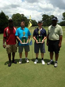 2ND PLACE: The Albany team of Eddie Mitcheson and Tim Leedon shot a 70 to place second in the 2013 Deltrice Riles Memorial Golf Tournament. Mitcheson and Leedon are shown with tournament organizers Gary Riles and his son, Ryan Riles.