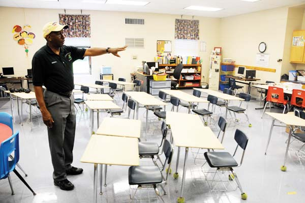 Dr. Larry Clark looks over a classroom at the temporary home of Jones-Wheat Elementary, which will have 2013-2014 classes on the campus of the old West Bainbridge Middle School.