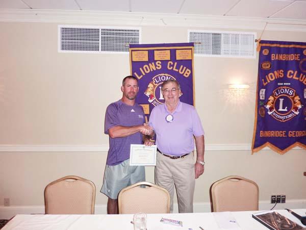 GUEST SPEAKER: Lion President Frank Loeffler thanking Coach Jeff Littleton for speaking to the Lions Club.