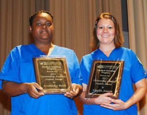 Photo of Award Winners: Being recognized for their achievement in Bainbridge State College's Medical Assisting program are, from the left, Ronnisha Bush, who was presented the Outstanding Academic Student Award, and Amelia Jensen, who was presented the Outstanding Clinical Student Award. Both students are from Bainbridge.