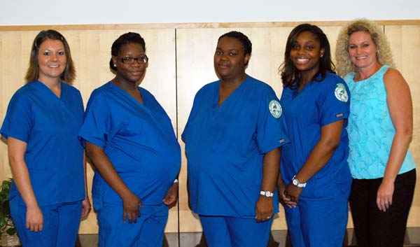 Graduates of the Bainbridge State College's Medical Assisting program stand with their instructor, Sherry Harrison. From the left, are Amelia Jensen, LaShondra Harris, Ronnisha Bush and Monique Groomes, all from Bainbridge, and Harrison.