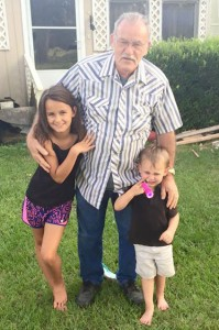 Grandpaw Lloyd Seals with his great granddaughter Kayla McEwen and great grandson Kash.