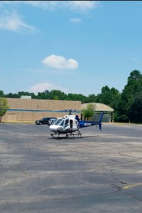 The life-flight helicopter prepares to load the injured Bainbridge man after the accident Tuesday.